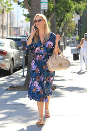 Reese Witherspoon topped off her strolling ensemble with a nude leather tote, also by Ferragamo.