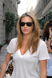 Classic black Ray-ban wayfarers are sunglasses du jour for Bar Refaeli.