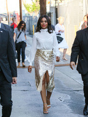 Regina Hall stopped by 'Kimmel' wearing a classic long-sleeve blouse.
