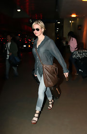 Renee Zellweger showed off her airport style while catching a late night flight out of LAX airport. Her brown leather tote bag was the perfect accent to her look.