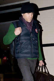 Ryan wears a blue down vest to the airport.