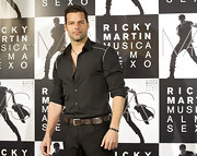 Ricky donned a black button-up top with white piping in Madrid.