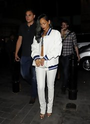 RiRi complemented her varsity-style jacket with a pair of skinny pants in a stark white shade.