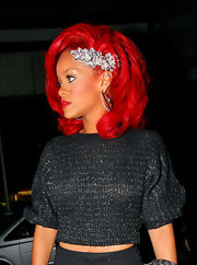Rihanna pinned her fiery red locks up in a silver hair pin.