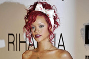 Rihanna helps turn on the holiday lights at the Westfield Shopping Center in White City.