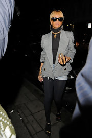 Rihanna offset her short cut off jeans with a black turtleneck and gray tweed blazer while out shopping in London.