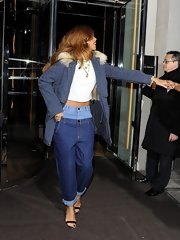Rihanna sported a navy fur trimmed utility jacket while out in London.