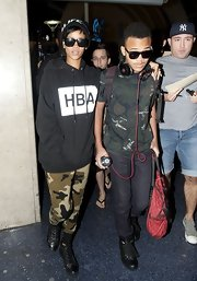 Rihanna paired her printed leggings with an oversize hoodie for a relaxed travel look.