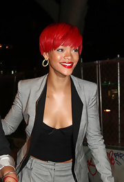 Rihanna showed off her cool gold hoop earrings while out and about in Soho.