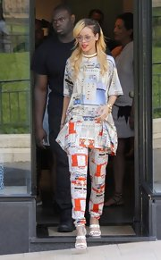 Rihanna showed off her eclectic style with this printed tunic blouse and matching pants.