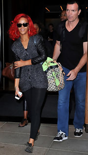 Rihanna sowed off her colorful monogrammed tote bag while leaving her NYC hotel.