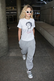Rita Ora kept it casual and comfy in a graphic tee during a flight.