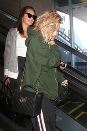 Rita Ora was seen at LAX carrying a boxy black bag by Chanel.