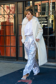 Rita Ora showed off her winter style with a cream-colored fur-collar coat while out in New York City.