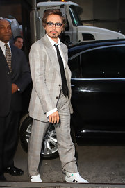 Robert made a television appearance looking stylish in a plaid pant suit with a black tie and casual athletic kicks.