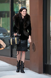Coco Rocha was spotted shooting an ad for Tory Burch carrying a studded black leather tote.