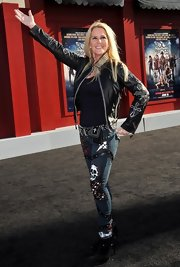Lita Ford completed her studded ensemble with a pair of matching sleek black suede ankle-boots.