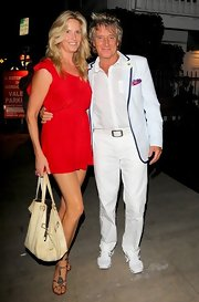 Penny Lancaster showed off her legs with a red mini dress as she was spotted out for dinner with her hubby.