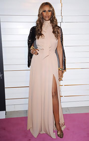Iman wore a nude '70s inspired ascot gown with a hip-high slit for the Rodeo Drive Walk of Style Award.