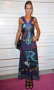 Victoria Hervey polished off her glam halter gown with a black leather tasseled clutch.