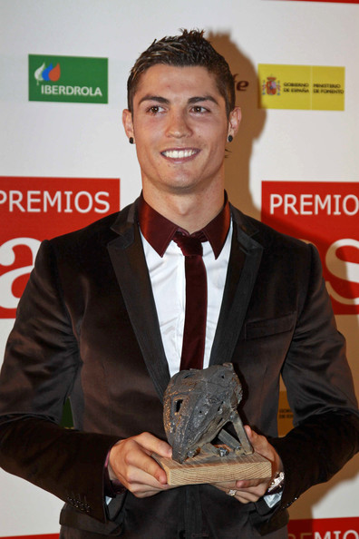 Cristiano Ronaldo looked dapper with dark spiked hair.