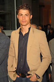 Cristiano rocks a big gold belt buckle!