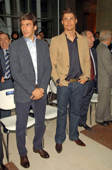 Cristiano Ronaldo wears an oversized gold belt buckle with his brown leather belt.