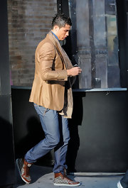 Cristiano Ronaldo was dapper in a tan blazer while out and about town.