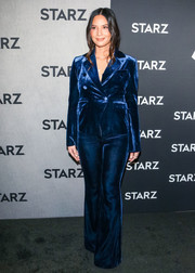Olivia Munn attended the premiere of 'The Rook' wearing a blue velvet pantsuit by Rachel Zoe.