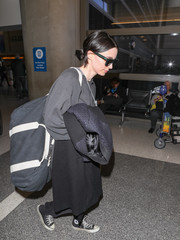 Rooney Mara made her way through the airport carrying a heavy duffel bag.