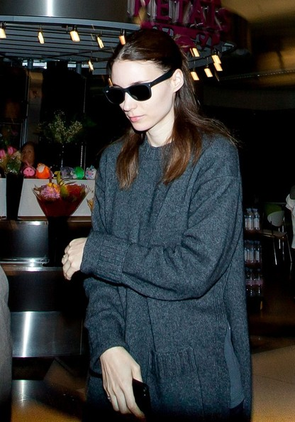 Rooney Mara hid her eyes behind a pair of Ray-Ban wayfarers while making her way through LAX.