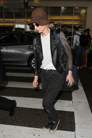 Black skinny jeans completed Rooney Mara's airport outfit.