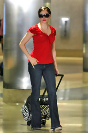It won't be hard for Rose to find her travel rollerboard on the luggage racks.