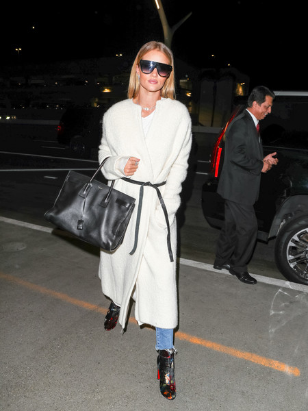 Rosie Huntington-Whiteley finished off her airport look with a pair of floral velvet ankle boots by Christian Louboutin.