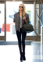 Rosie Huntington-Whiteley departed from LAX looking sporty in a Stella McCartney printed jacket and skinny jeans.