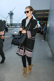 Rosie Huntington-Whiteley sealed off her airport look with a pair of tasseled suede boots, also by Isabel Marant.