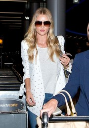 Rosie Huntington-Whiteley kept her eyes hidden behind a pair of designer shield sunglasses as she made her way through LAX.