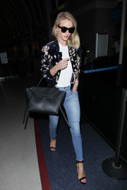 Rosie Huntington-Whiteley made her way through LAX looking chic in her Magda Butrym Tokyo bomber jacket.