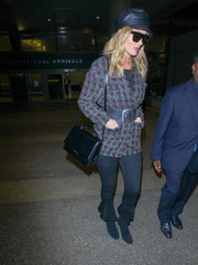 Rosie Huntington-Whiteley completed her airport look with a pair of blue knit ankle boots by Gianvito Rossi.