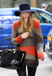 Rosie Huntington-Whiteley wore a navy wide brimmed hat while out in London.