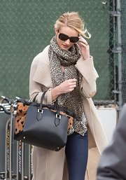 Rosie Huntington-Whiteley kept cozy with an animal-print scarf teamed with an oversized cardigan.