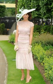 Danielle Bux wore a light pink lace dress with a drop waist and flowing skirt.