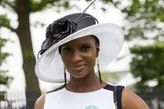 Denise Lewis wore this white wide-brimmed hat with black embellishments.