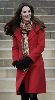 The Duchess of Cambridge brought out another drool-worthy coat with this vibrant red piece.