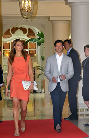 Princess Madeleine attended the brunch at the Prince's Palace in Monaco in a vibrant tangerine dress.