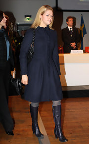 Princess Madeleine dressed appropriately for the chilly weather in a pair of heeled mid-calf boots as she participated in a UN convention.
