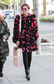 Ruby Rose kept warm in oh-so-cool style with this neon-pink and black faux-fur coat by Marc Jacobs (which matched her hair and shades!).