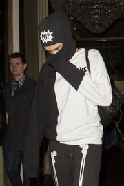 Cara Delevingne tried to go incognito with a 'POP' ski mask during a night out, but those famous eyebrows gave her away.