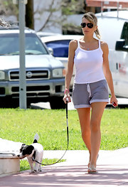 Rita oozed casual-cool in her aviators, white tank top and shorts as she walked the streets in Miami.