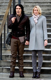 Greta Gerwig looked ultra chic on the set of 'Arthur' in buckled brown ankle boots, gray skinnies, and a wool coat.
